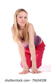 young pretty teenage girl standing in the kneeling position