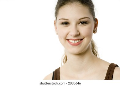 A young pretty teenage woman on white background