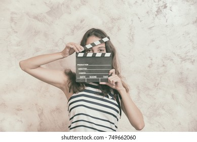 Young pretty woman actress smiling portrait posing for audition analog photography vintage color effect