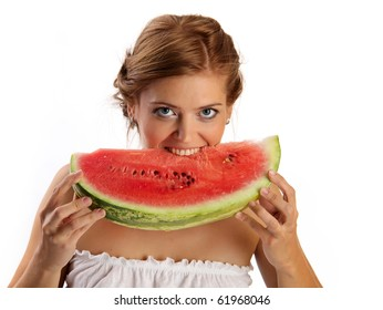 Young pretty woman bites a slice of watermelon