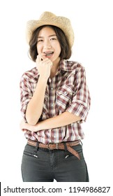 Young pretty woman in a cowboy hat and plaid shirt with arms crossed isolated on white background