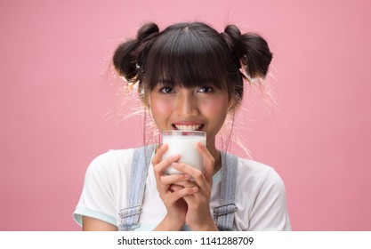 Young pretty woman drinking milk, health nutrition