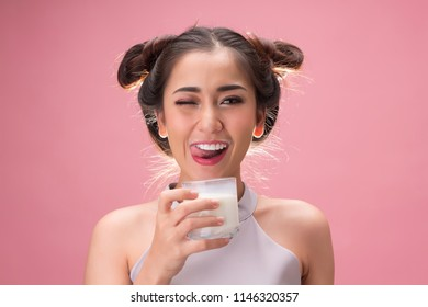 Young pretty woman drinking milk with happiness
