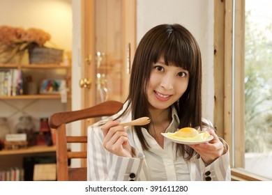 young pretty woman eating a dessert