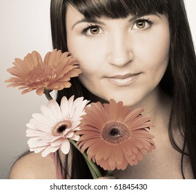Young pretty woman with flowers in her hands