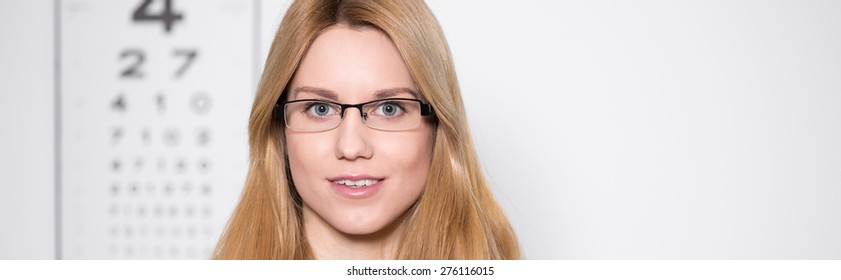 Young pretty woman in glasses at oculist's office