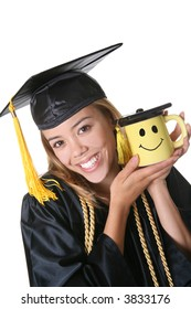 A young pretty woman graduate with mug