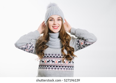 Young pretty woman in grey hat and scarf on the white background