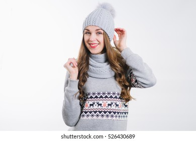 Young pretty woman in hat and scarf on the white background