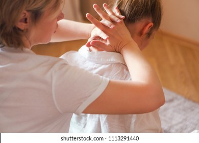 Young pretty woman head and shoulders massage in spa salon