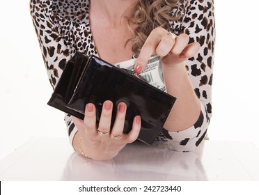 Young pretty woman holding dollars in her wallet
