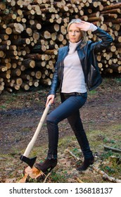 Young pretty woman with huge axe