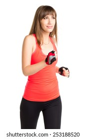 Young  pretty woman jogging on training isolated on white background. Smiling girl running in orange sportswear outfit