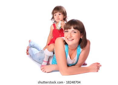 A young pretty woman with a little girl sitting on her back and eating over white background