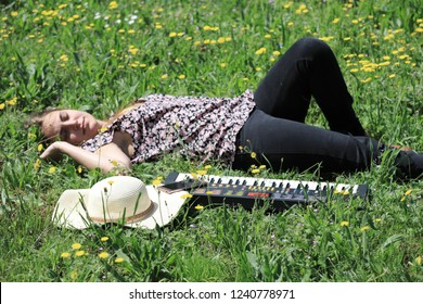 young and pretty woman lying in a flowery meadow in the spring