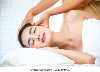 Young pretty woman lying on bed in spa room for health care her body with spa massage for good skin and beautiful body
