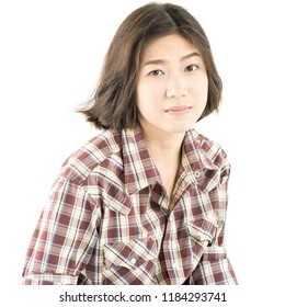 Young pretty woman in plaid shirt posing in studio with isolated on white background