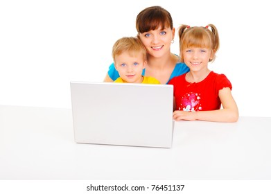 Young pretty woman is playing with her children