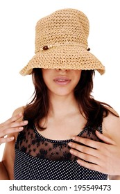 A young pretty woman in a portrait picture with a straw hat over her eye's, isolated on white background.