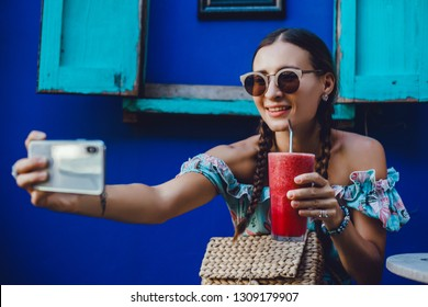 young pretty woman posing in the street with phone, outdoor portrait, hipster girls, sisters, chic, tablet, internet, using smartphone, close-up fashion model, post in instagram, facebook