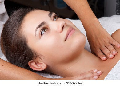 Young pretty woman receiving treatments in beauty salons. Young beautiful dark-haired woman in the office beautician lying on the couch. Ultrasonic cleaning procedure. Hardware cosmetology.