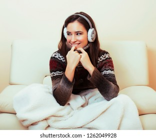young pretty woman sitting in comfortable chair with coffee and