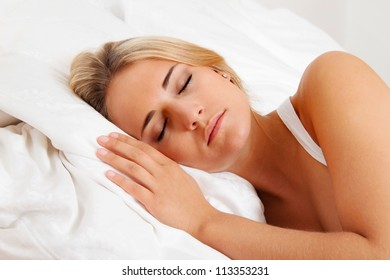 a young pretty woman sleeping in bed and recover.