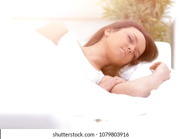 Young pretty woman sleeping at bright room