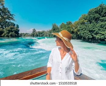 Young pretty woman is standing close up on the Manavgat waterfall background in Turkey