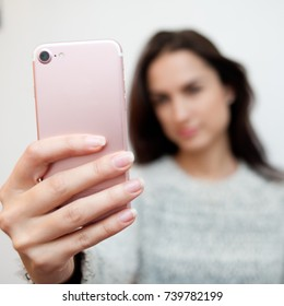 Young pretty woman taking selfie