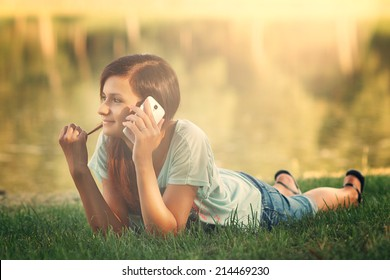 Young pretty woman talking on mobile phone