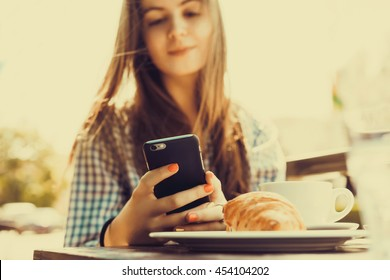 young pretty woman using laptop and smartphone in cafe, breakfast, launch, branch, outdoor portrait, closeup fashion model, phone touch screen, hipster, smile happy face
