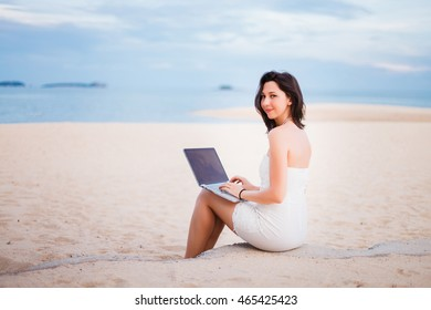 young pretty woman using laptop