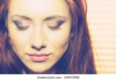 young pretty woman's face with makeup closeup