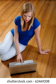 Young pretty women on wooden floor relaxing and using laptop computer