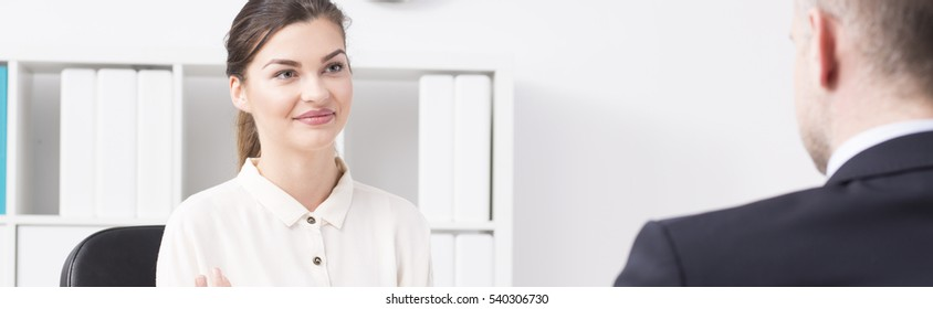 Young pretty worker talking with her boss