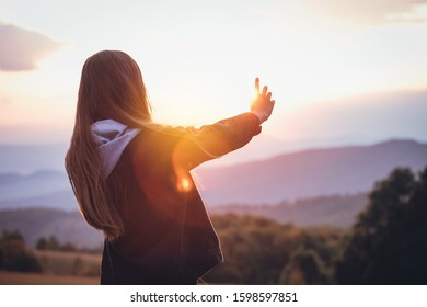 Young Prety Girl Outstretched Arm Covers the Sun - Shutterstock ID 1598597851