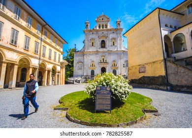 A young priest crosses the Sacro Monte di Varallo square, Italy , 24 May 2017