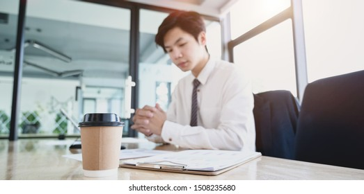 Young professional accountant preparing financial reports for the next meeting