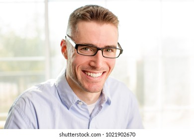 Young professional business man wearing glasses