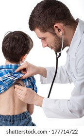 Young professional doctor examining little sick boy