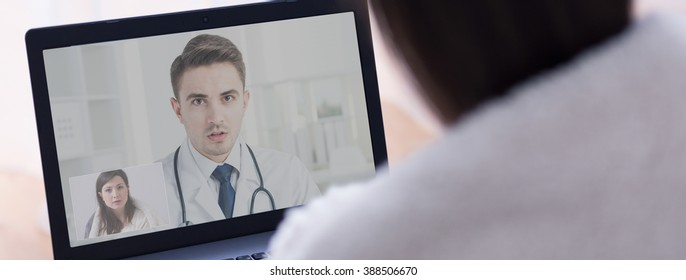 Young professional doctor giving advise to his young patient online on video conference