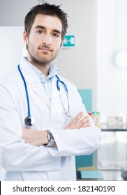 Young professional doctor at hospital with crossed arms