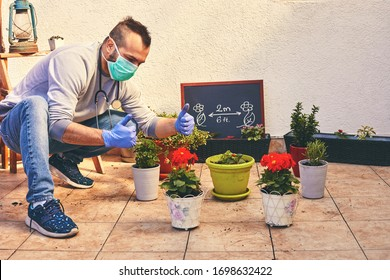 Young professional gardener take care of his plant wearing mask and gloves. Gardening concept. Epidemic concept.