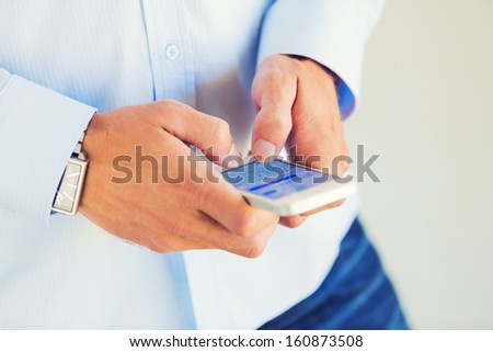 Young Professional, Handsome Man Using Smart Mobile Phone, Texting, Sending Text Message