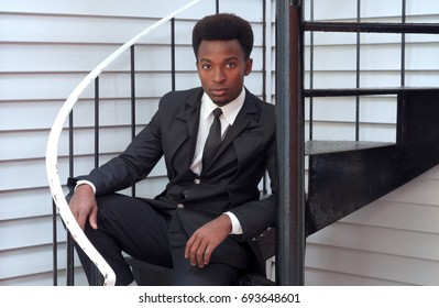 young professional man buisinessman sitting stairs handsome modern style executivevv