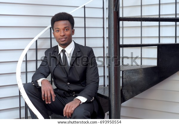 young professional man buisinessman sitting stairs handsome modern style executive