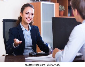 Young professional teaching new assistant in practice at company