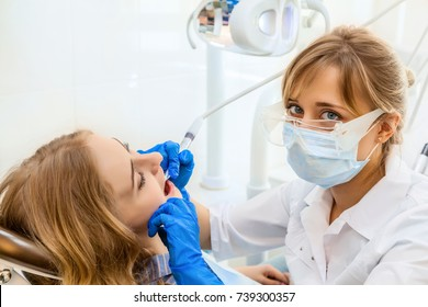 Young Professional Woman Dentist working with a Female Patient