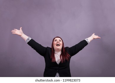 Young professional woman wearing buisness suit throwing up arms